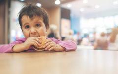 little-girl-eating-a-bread